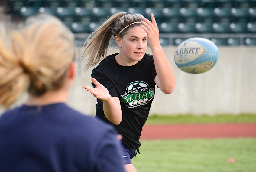 Emma Langley tosses the ball to a teammate during a passing drill Friday at UPEI.