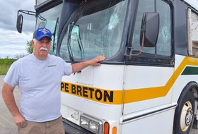 Gary Pozzebon, president of the Cape Breton Drag Racing Association, shows some of the damage to their bus at their race track off Grand Lake Road in Sydney. Pozzebon said they've occurred several incidents of vandalism and theft during the five years they've been there and are now having discussions about the land-use agreement they have with local ATV groups. Sharon Montgomery-Dupe/Cape Breton Post