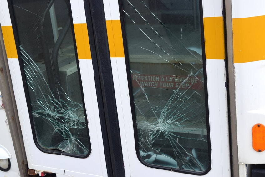 Glass smashed in the doors of the bus owned by the Cape Breton Drag Racing Association, at their race track off Grand Lake Road in Sydney. Sharon Montgomery-Dupe/Cape Breton Post   - Sharon Montgomery