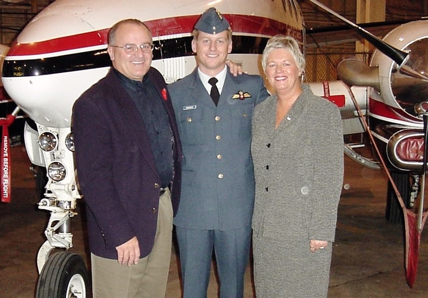 Capt. Steve MacDonald, centre, with parents Daryl and Alice MacDonald. Contributed - Saltwire network