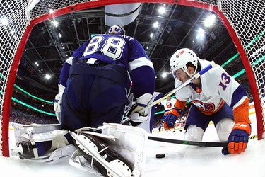 Mathew Barzal of the New York Islanders scores against Andrei Vasilevskiy of the Tampa Bay Lightning during Game 1 of the Stanley Cup semifinals at Amalie Arena on June 13, 2021 in Tampa