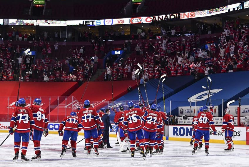 Canadiens player salute fans at the Bell Centre after beating the Winnipeg Jet 3-2 in overtime of Game 4 of North Division final to sweep the best-of-seven playoff series.