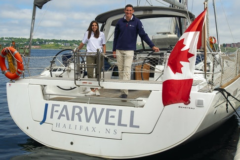 Sarah Godin and Jeff Farwell pose for a photo aboard their company's sailboat along the Halifax waterfront on Monday, June 14, 2021. Godin recently became an equity partner and accepted the position of president of the company.