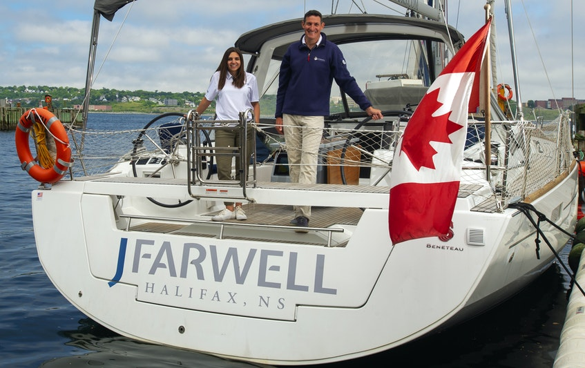 Sarah Godin and Jeff Farwell pose for a photo aboard their company's sailboat along the Halifax waterfront on Monday, June 14, 2021. Godin recently became an equity partner and accepted the position of president of the company. - Ryan Taplin