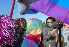Supporters wore rainbow colours and raised Pride flags outside of East Wiltshire Intermediate School June 14 after news on June 10 that some children at the school were bullied for taking part in Pride and Rainbow Day activities in honour of 2SLGBTQIA+ students and staff.