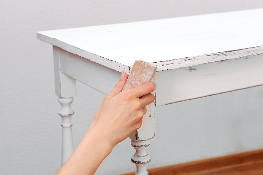 Prepare for painting by making sure your surface is smooth. While it isn't necessary to sand an entire room - just look for any flaws or bumps - if you're painting furniture, Rosslyn Gillan suggests doing a