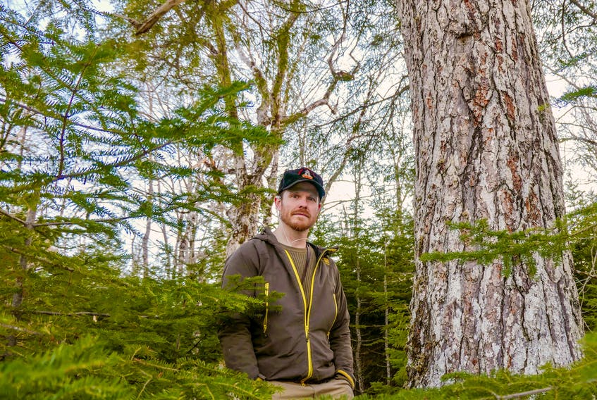 Adam Malcolm, founder of the Facebook group Stop Clearcutting Unama'ki and the Instagram account @ns.speciesatrisk, in the woods near River Inhabitants, Richmond County in February 2021. CONTRIBUTED