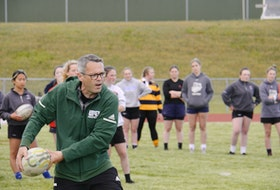 Head coach James Voye passes the ball during a drill at an identification camp for the Prince Edward Island women's rugby 7s team at UPEI on Friday, June 11. The team will compete in the 2022 Canada Summer Games in Ontario's Niagara Region. Voye, a Summerside native, was recently named head coach of the UPEI women's rugby team.