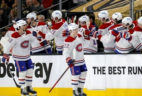 The Canadiens' Cole Caufield (22) is congratulated after scoring his first NHL playoff goal in 4-1 loss to the Golden Knights Monday night at T-Mobil Arena in Las Vegas in Game 1 of Stanley Cup semifinal series.
