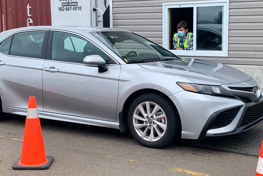 A vehicle stops at the Nova Scotia entrance control point at the N.B. border. Nova Scotia has imposed new vaccination and isolation measures for New Brunswick visitors while opening up to Prince Edward Island and Newfoundland and Labrador with no strings attached. - File