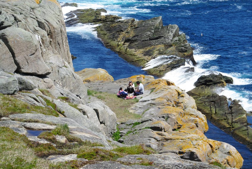 Janny VanHouwelingen sent us this photo of a family picnic on the Beamer at Flatrock, N.L. Janny said she was hiking the Father Troy Path of the East Coast Trail when she came across this family sitting comfortable on the rocks at the sea's edge. A lovely day for a walk in Newfoundland and Labrador. Thank you for this photo Janny.