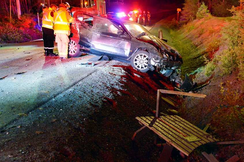 The driver of a car that overturned in an alleged street race early Tuesday morning apparently fled the scene in the other vehicle involved. Keith Gosse/The Telegram