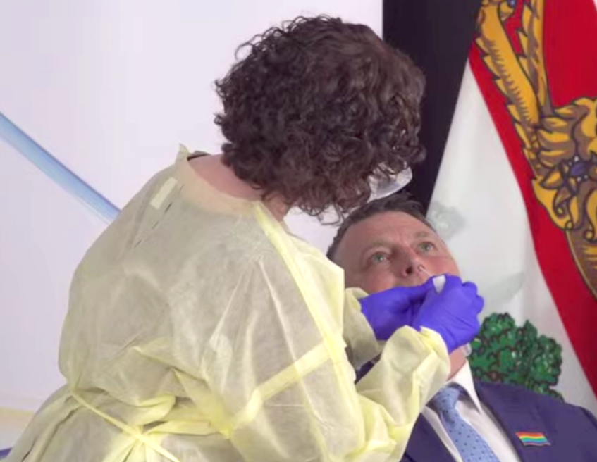 Premier Dennis King gets swabbed during a briefing on Tuesday, June 15. - Screen  grab