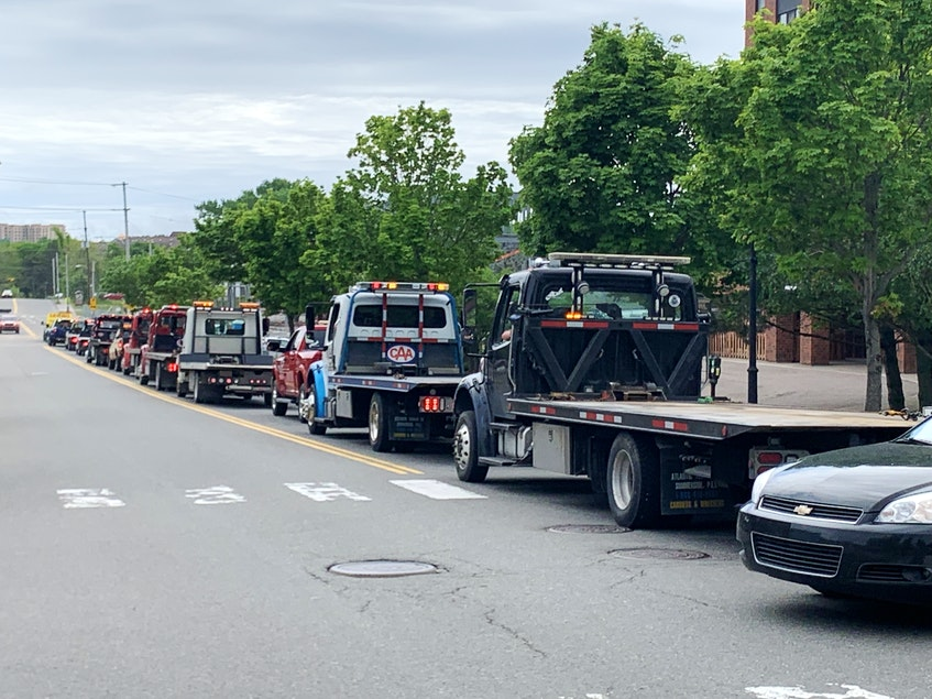 A slow-moving procession of tow trucks and flatbeds made its way along the Esplanade in Sydney on Tuesday. The rally of unity was staged by the owners and operators in the local tow truck industry who are unhappy with CBRM plans to implement a new tow truck licensing bylaw that they say is unfair. DAVID JALA/CAPE BRETON POST