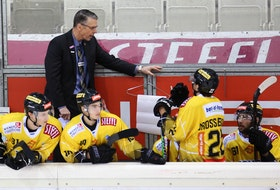 Vienna Capitals head coach Dave Cameron talks to his players during a game in the International Central European (ICE) Hockey League. Cameron, who resides in Kildare Capes, will return to the Capitals for a fourth season in August.