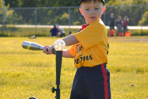 Four-year-old Wesley Ferguson, son of Sean and Alyssa (Kavanaugh) Ferguson of Sydney, keeps his eye on the pickleball during the opening day of the Sydney and District Little League mini program season at Vince Muise Memorial Ball Field in Sydney River on Monday. For more coverage, see page B1. JEREMY FRASER/CAPE BRETON POST.