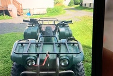 The missing quad is green and has a camo seat. The vehicle identification number is 5Y4AH06W42A301335 and it may have the Nova Scotia license plate KF461.