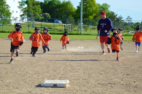 Members of the Sydney and District Little League mini program run the bases during on-field practice at Vince Muise Memorial Ball Field in Sydney River on Monday. Despite having to deal with stolen equipment and the COVID-19 pandemic, Sydney and District Little League began its 2021 season on time. JEREMY FRASER • CAPE BRETON POST