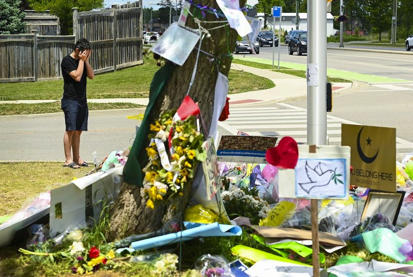 A man visits a memorial to the victims of the deadly vehicle attack on five members of the Canadian Muslim community in London, Ont., on Monday, June 14, 2021.