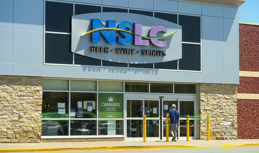 A customer enters the Mill Cove NSLC outlet. - Ryan Taplin