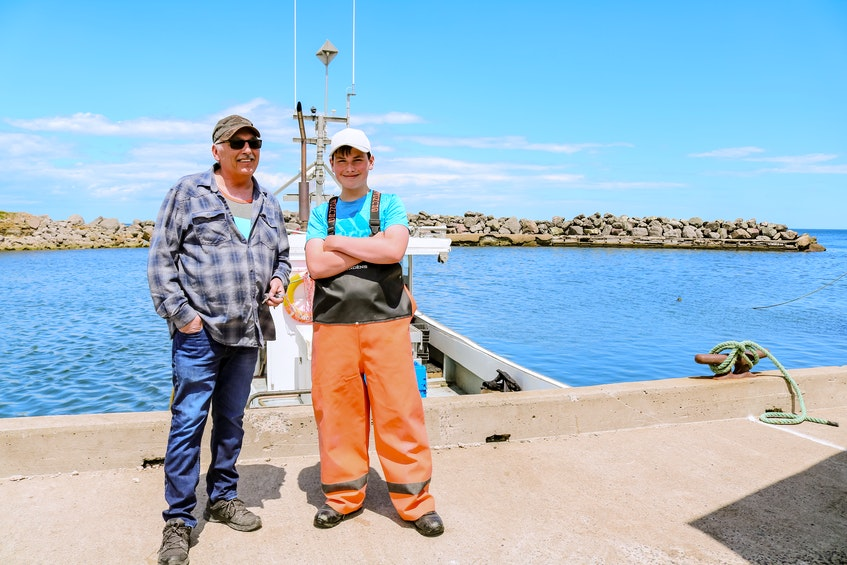 Nate Boone with his grandfather, Willie Cadden, left, who has been lobster fishing for about 45 years. JESSICA SMITH • CAPE BRETON POST