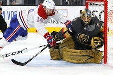 LAS VEGAS, NEVADA - JUNE 14:  Nick Suzuki #14 of the Montreal Canadiens trips over Marc-Andre Fleury #29 of the Vegas Golden Knights as he defends the net in the third period in Game One of the Stanley Cup Semifinals during the 2021 Stanley Cup Playoffs at T-Mobile Arena on June 14, 2021 in Las Vegas, Nevada. The Golden Knights defeated the Canadiens 4-1.