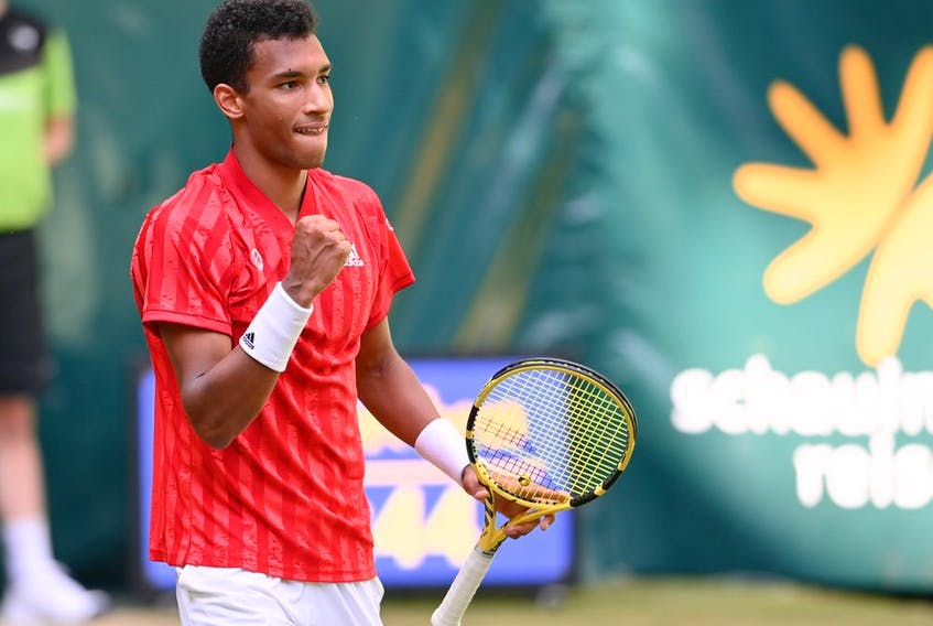 Félix Auger-Aliassime of Montreal celebrates after winning his match against Roger Federer of Switzerland in the Noventi Open at OWL-Arena on June 16, 2021, in Halle, Germany.