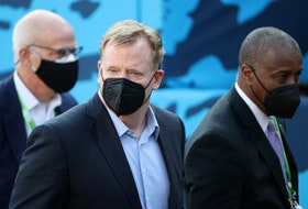NFL commissioner Roger Goodell looks on while wearing a mask before Super Bowl LV.