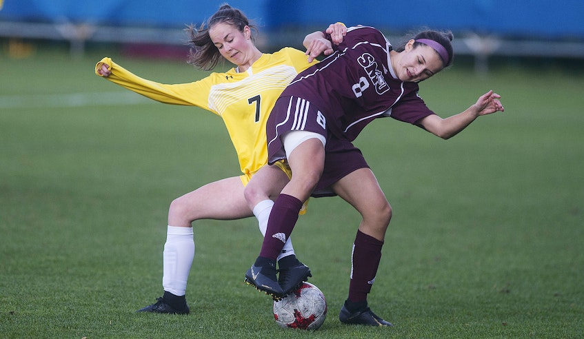 Dalhousie Tigers defender Breagh Bates and Saint Mary's Huskies midfielder Talia South battle for the ball during a 2019 AUS women's soccer match at the Wanderers Grounds. - Ryan Taplin / The Chronicle Herald