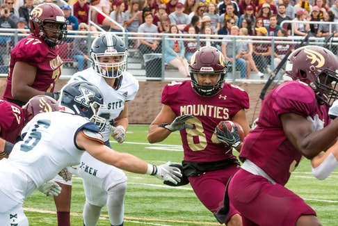 Mount Allison Mounties receiver Josh Hicks carries the ball against the defence of the St. Francis Xavier X-Men during a 2019 Atlantic university football regular-season game. - Dave Mathieson / Saltwire Network