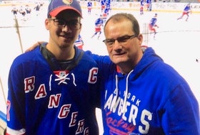 Ron Hennessey, right, and his son, Lal, enjoy a New York Rangers' game at Madison Square Garden. Ron Hennessey, who has cheered for the Rangers for over 40 years, is excited to have Summerside native Gerard (Turk) Gallant named as head coach of the Original 6 NHL franchise.