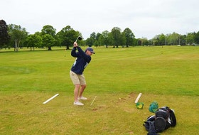 Brodie McGregor of Stratford gets in some practice swings on the driving range at the Belvedere Golf Course on Tuesday, June 15. Officials with the Belvedere Golf Course are in talks with management at the Charlottetown Curling Club about merging the two operations.