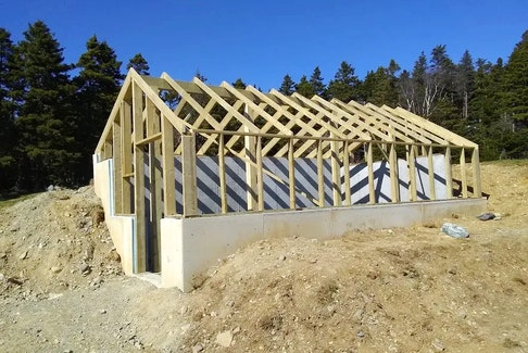 This photo shows an earth-sheltered greenhouse as it was under construction at O'Brien Farm in St. John's this spring. It's the sort of work that will be undertaken in seven communities across the province as part of the Food Producers Forum's Greenhouse Outreach Project. — Food Producers Forum