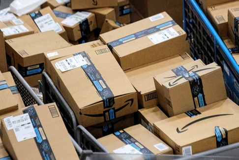 Amazon packages wait to be delivered. The company has been criticized for the many fake reviews posted to its site, but it says its not to blame.