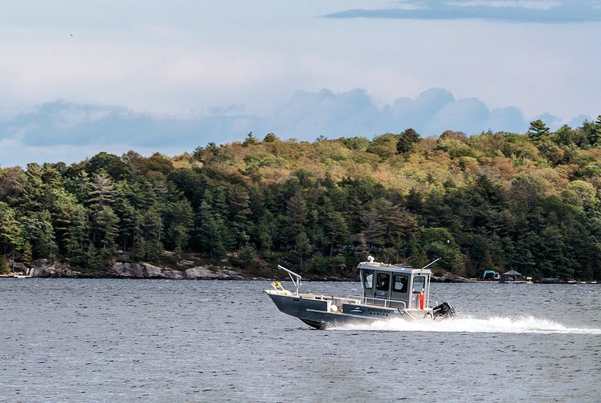 A boat drives across Lake Joseph, photographed September 26, 2019, near where a collision involving Linda and Kevin O'Leary occurred.