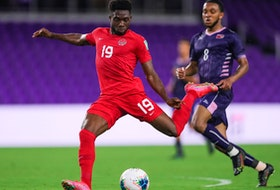 Alphonso Davies of Canada plays the ball against Bermuda during a CONCACAF World Cup qualifying game in Orlando, Fla., on March 25, 2021.