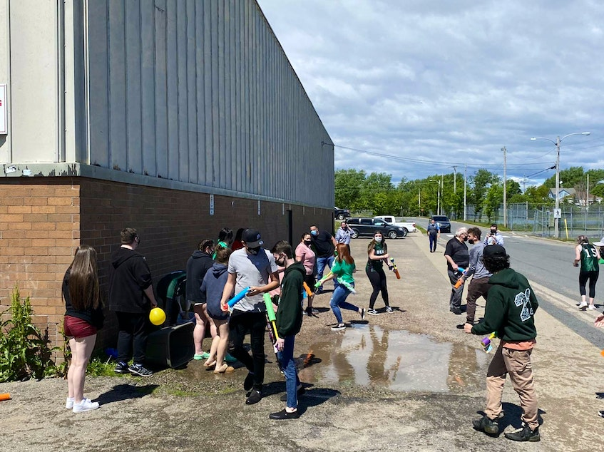 Teachers at Breton Education Centre in New Waterford pranking the graduating students by attacking  them with water guns outside the school on June 11. Graduating students pranked the teachers that morning and the teachers were retaliating. CONTRIBUTED
