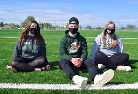 Grade 12 students from Breton Education Centre, from the left, Kelsey Woodland, Drew Baldwin and Kelly Pinhorn, in the soccer field near the school on Tuesday. The students say since holding the traditional end of the year prank day at the high school June 11 they are being called vandals, when in reality it was a tradition they upheld that was sanctioned by the school. BEC denies giving permission. Sharon Montgomery-Dupe/Cape Breton Post