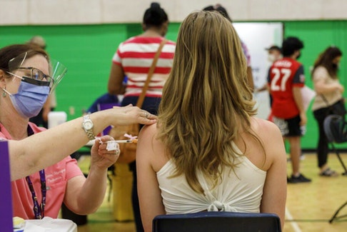 A teen is vaccinated at a clinic in Toronto on Wednesday, May 19, 2021.