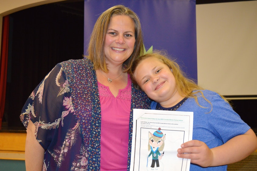 Myla Doucette, right, a Grade 3 student at Gulf Shore Consolidated School in North Rustico, P.E.I., poses with her entry into the 2023 Canada Winter Games mascot design contest. Standing beside her is her mother, Terra. - Dave Stewart • The Guardian