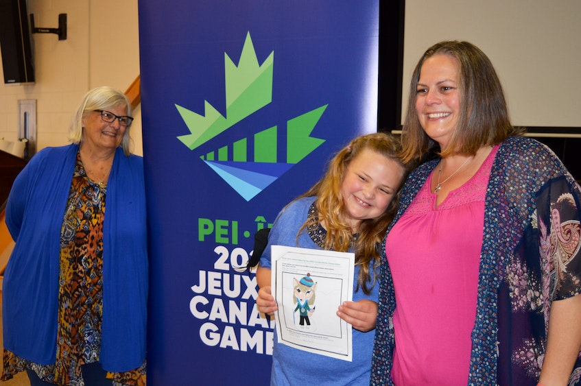 Marilyn Doucette looks on proudly as her granddaughter, Myla, centre, and her daughter, Terra, right, pose for pictures after the 2023 Canada Winter Games host society announced on Tuesday, June 14, that Myla's mascot design was the winning entry in the provincewide contest. - Dave Stewart • The Guardian
