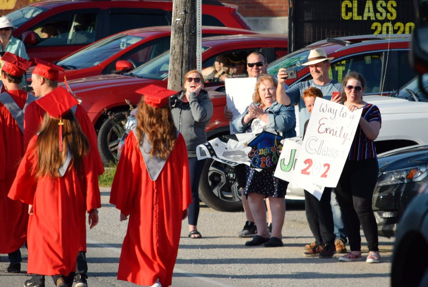 The BMHS Class of 2020 is cheered on by well-wishers as they parade through the Barrington Passage business district last year. Kathy Johnson