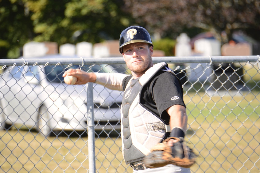 Cole MacLaren warms up a pitcher last summer before a Kings County Baseball League game in Morell. - Jason Malloy • The Guardian