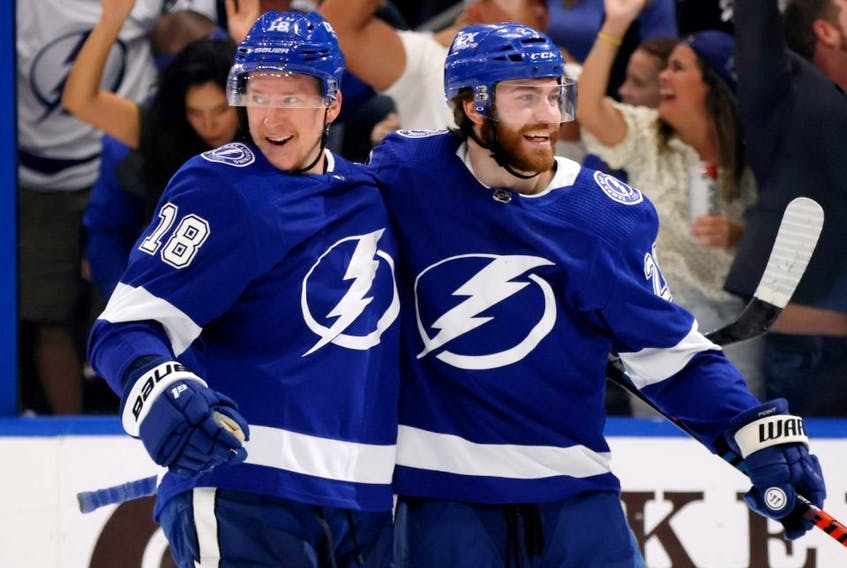 Lightning forward Ondrej Palat, left, celebrates with Brayden Point after scoring a goal against the Islanders during the second period in Game 2 of the Stanley Cup Semifinals at Amalie Arena in Tampa, Fla., Tuesday, June 15, 2021.
