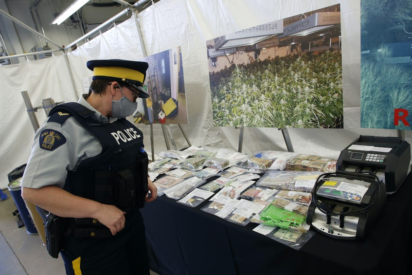 The RCMP's federal serious and organized crime unit has charged 14 people with 100 offences in connection with an 11-month investigation into a drug trafficking ring in Halifax Regional Municipality. Seen here is $369,000 in cash that was seized, along with bill counting machines. - Tim  Krochak