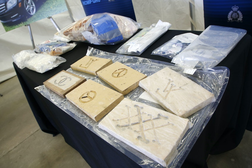 The RCMP's federal serious and organized crime unit has charged 14 people with 100 offences in connection with an 11-month investigation into a drug trafficking ring in Halifax Regional Municipality. Seen here is  3.5 kg of cocaine and pills seized during the investigation. - Tim  Krochak
