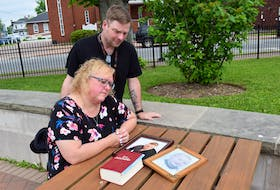 Laureen and Lewis Rushton look at photos of their son, Lucas, who passed away on May 31. They hope sharing Luca's story will help others struggling with mental health.
