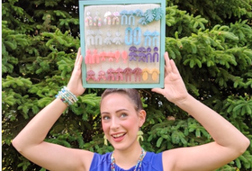 Truro entrepreneur Jerika Henderson holds a display case of her resin earrings. The 24-year-old operates a jewelry making business called Jerika's Jemz, and sells her products at the Truro Farmers' Market and on Etsy.  - Contributed