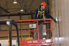 Electrician Mitchell Ellsworth for Jeff Deuville Electrics Ltd. works in the Debert Aviation Centre earlier this spring.