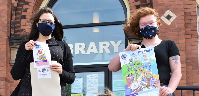 Colchester-East Hants Public Library's head of youth services Jenn Atkinson (left) and April Sharpe hold up promotional material regarding this year's Summer Reading Challenge. - Richard MacKenzie